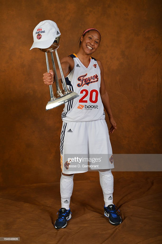 Briann January #20 of the Indiana Fever poses for portraits with the Championship Trophy after Game four of the 2012 WNBA Finals on October 21, 2012 at Bankers Life Fieldhouse in Indianapolis, Indiana.