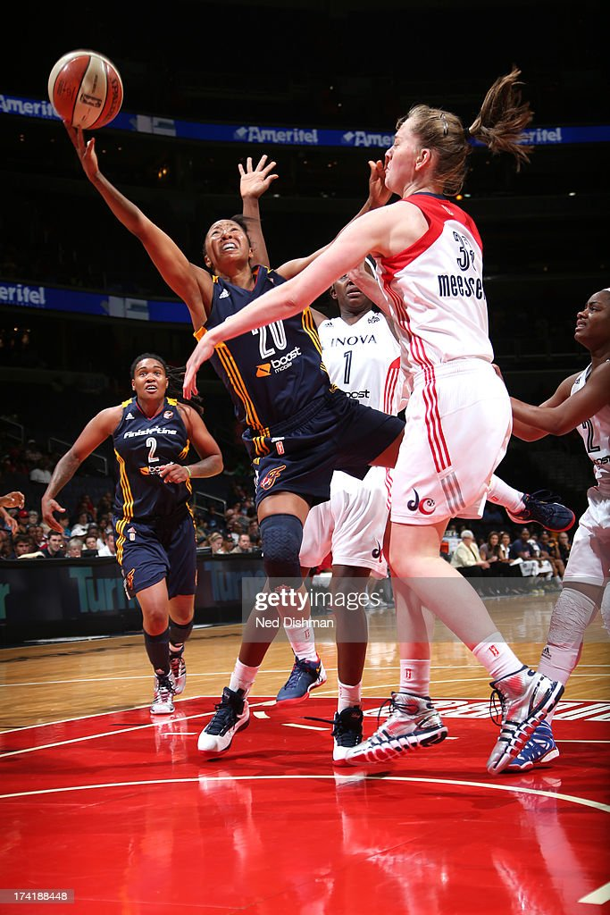 <a gi-track='captionPersonalityLinkClicked' href=/galleries/search?phrase=Briann+January&family=editorial&specificpeople=4530291 ng-click='$event.stopPropagation()'>Briann January</a> #20 of the Indiana Fever shoots against Emma Meesseman #33 of the Washington Mystics at the Verizon Center on July 21, 2013 in Washington, DC.