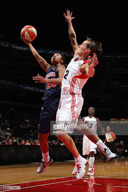 Briann January of the Indiana Fever shoots against Kelly Miller of the Washington Mystics at the Verizon Center on June 21 2011 in Washington DC NOTE...