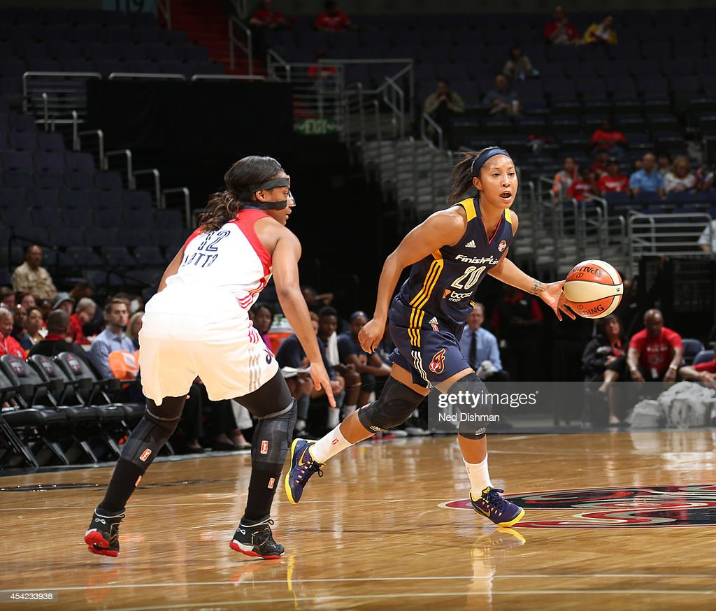 Briann January #20 of the Indiana Fever shoots the ball against Ivory Latta #12 of the Washington Mystics in Game Two of the Eastern Conference Semifinals during the 2014 WNBA Playoffs on August 23, 2014 at the Verizon Center in Washington, DC.