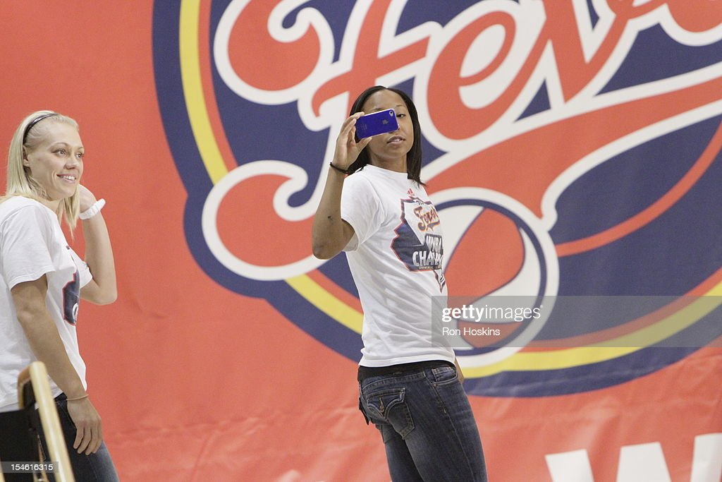 Briann January records her experience during the Indiana Fever's WNBA Championship celebration on October 23, 2012 at Bankers Life Fieldhouse in Indianapolis, Indiana.