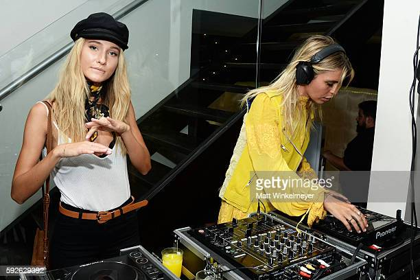 Brianna Barnes and DJ Sam Blacky attend the ARYA Curcumin Presents The Yellow Social at Private Residence on August 20 2016 in Los Angeles California