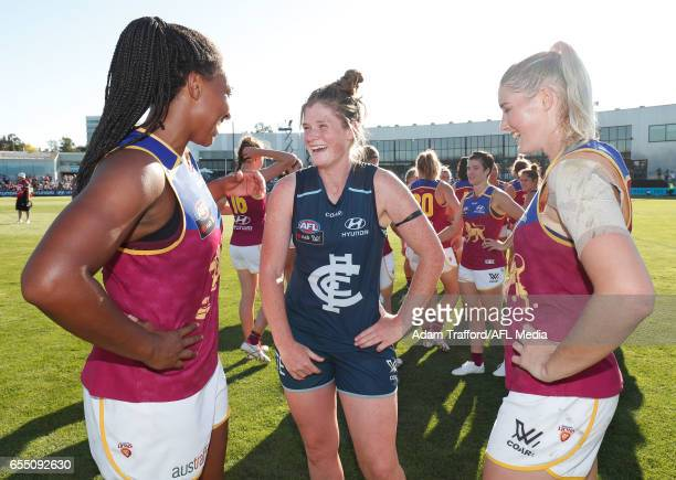 Brianna Davey of the Blues chats to Sabrina FrederickTraub and Tayla Harris of the Lions during the 2017 AFLW Round 07 match between the Carlton...