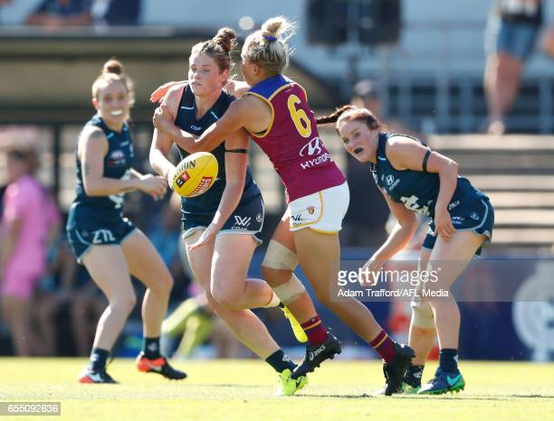Brianna Davey of the Blues is tackled by Megan Hunt of the Lions during the 2017 AFLW Round 07 match between the Carlton Blues and the Brisbane Lions...