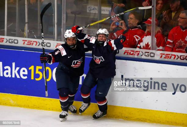 Brianna Decker and Kendall Coyne of the United States celebrate a game winning overtime goal by Hilary Knight while playing Canada in the gold medal...