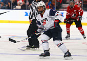 Brianna Decker of Team USA skates up the ice against Team Canada during a Sochi preparation game at the Air Canada Centre December 30 2013 in Toronto...