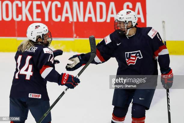 Brianna Decker of United States celebrates her second period goal against Canada with Megan Bozek at the 2017 IIHF Womans World Championships at USA...