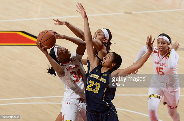 Brianna Fraser of the Maryland Terrapins drives to the hoop against Maria Backman of the Michigan Wolverines at Xfinity Center on January 19 2017 in...