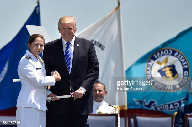 Brianna Lauren Grisell of Brookfield is congratulated by President Donald Trump after he awarded her commission at the United States Coast Guard...