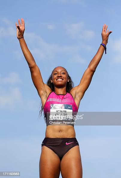 Brianna Rollins celebrates on the podium after winning the Women's 100 Meter Hurdles final on day three of the 2013 USA Outdoor Track Field...