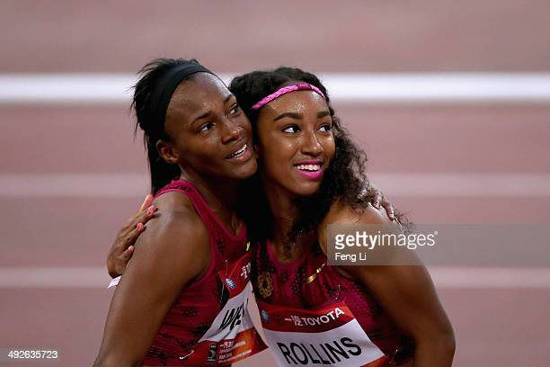 Brianna Rollins of the United States celebrates winning the Women's 100m hurdles with her teammate Kellie Wells during 2014 IAAF World Challenge...