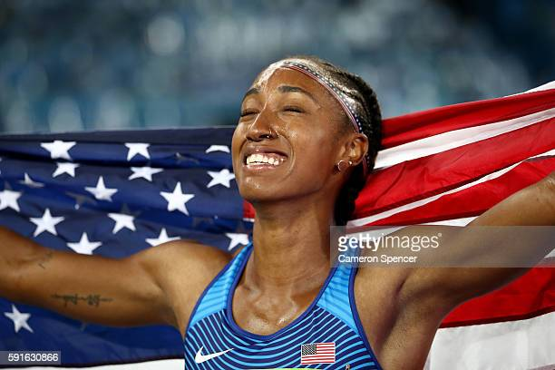 Brianna Rollins of the United States celebrates with the American flag after winning the gold medal in the Women's 100m Hurdles Final on Day 12 of...
