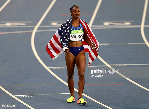 Brianna Rollins of the United States reacts with the American flag after winning the gold medal in the Women's 100m Hurdles Final on Day 12 of the...