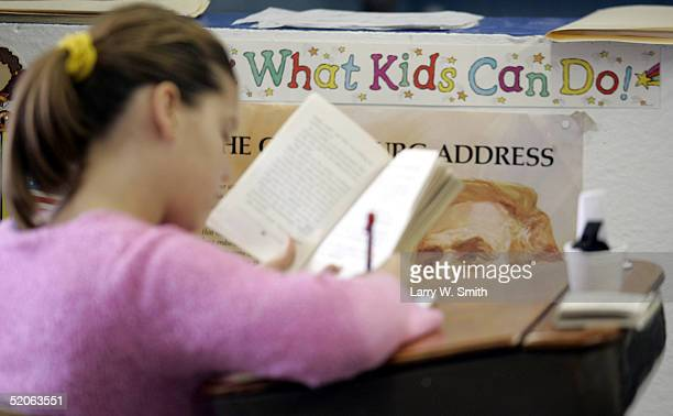 Brianna Taylor a fifth grade student at the Hill Public School works on a book report January 25 2005 near Bayard Nebraska The eight student one room...