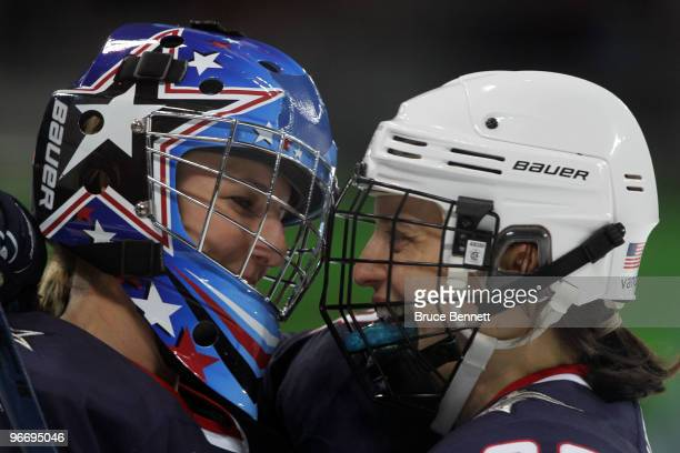 Brianne Mclaughlin and Kerry Weiland of the United States celebrate after defeating China during their women's ice hockey preliminary game at UBC...