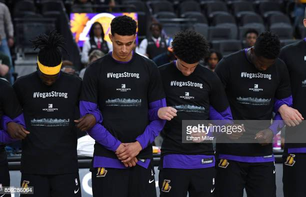 Briante Weber Kyle Kuzma Lonzo Ball and Julius Randle of the Los Angeles Lakers wear #VegasStrong Tshirts as they lock arms during a moment of...