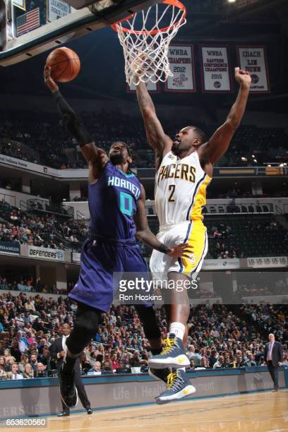 Briante Weber of the Charlotte Hornets goes up for a shot against Rodney Stuckey of the Indiana Pacers during a game on March 15 2017 at Bankers Life...
