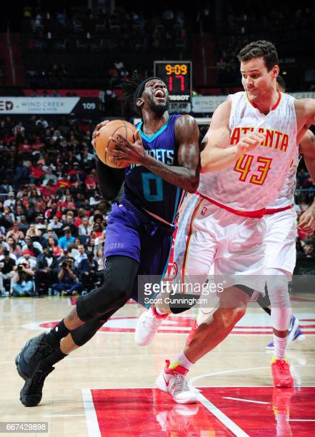 Briante Weber of the Charlotte Hornets handles the ball against Kris Humphries of the Atlanta Hawks during the game on April 11 2017 at Philips Arena...