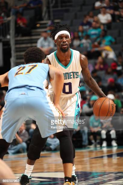 Briante Weber of the Charlotte Hornets handles the ball against the Denver Nuggets on March 31 2017 at Spectrum Center in Charlotte North Carolina...