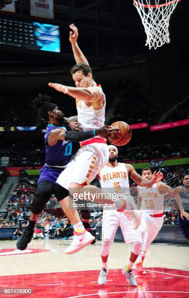 Briante Weber of the Charlotte Hornets passes the ball against Kris Humphries of the Atlanta Hawks during the game on April 11 2017 at Philips Arena...
