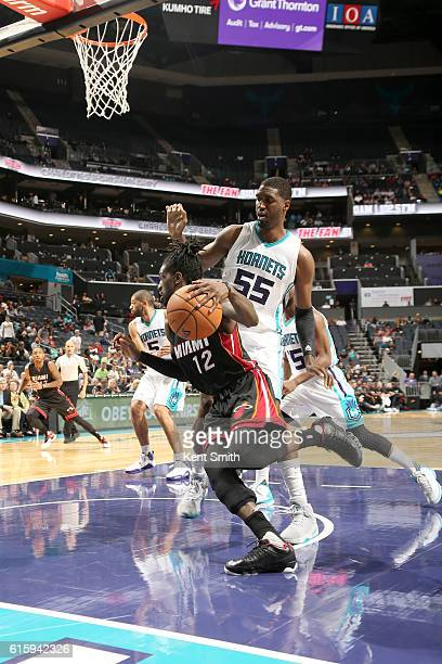 Briante Weber of the Miami Heat drives to the basket against the Charlotte Hornets on October 20 2016 at the Spectrum Center in Charlotte North...