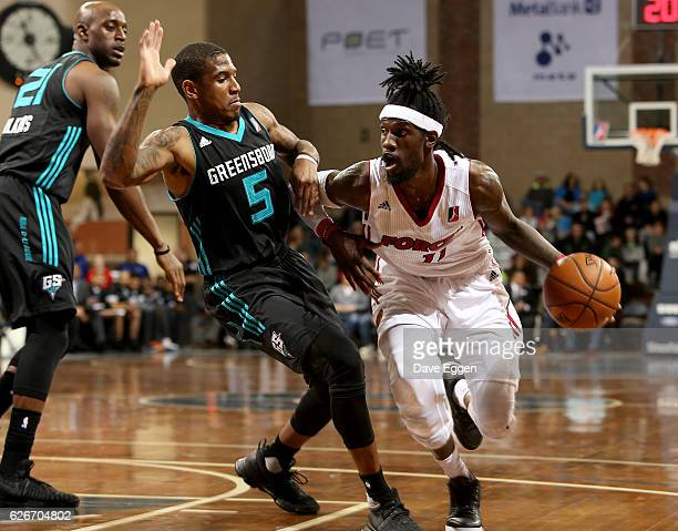 Briante Weber of the Sioux Falls Skyforce drives against Xavier Munford from the Greensboro Swarm at the Sanford Pentagon November 29 2016 in Sioux...