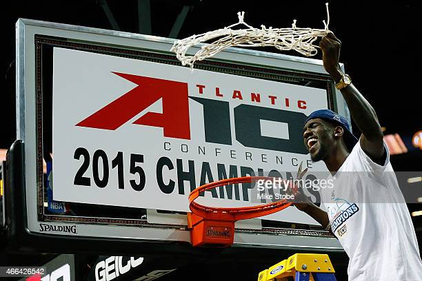 Briante Weber of the Virginia Commonwealth Rams celebrates by cutting down the net after defeating the Dayton Flyers in the Atlantic 10 Basketball...
