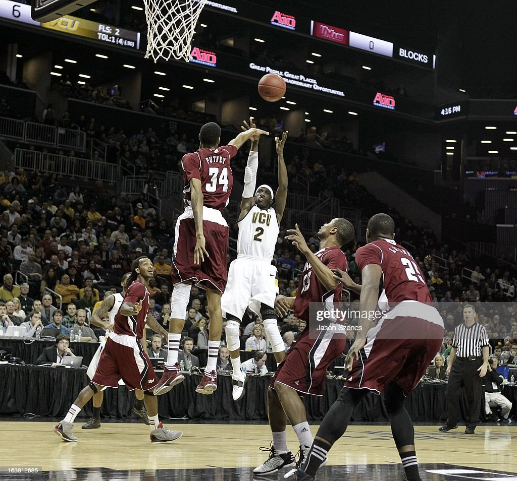 Briante Weber #2 of the Virginia Commonweath Rams puts up a shot past Raphiael Putney #34 of the Massachusetts Minutemen in the first half during the Atlantic 10 Basketball Tournament - Semifinals at the Barclays Center on March 16, 2013 in the Brooklyn borough of New York City.