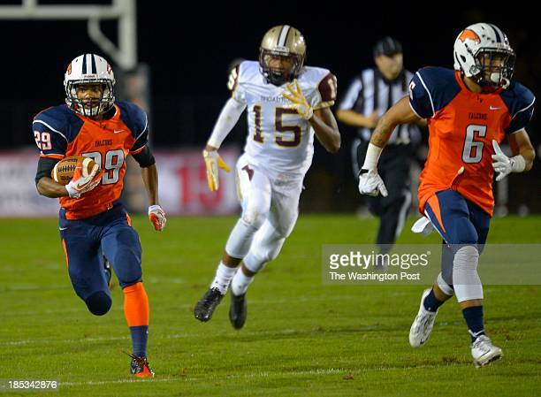 Briar Woods defensive back Chris McMillian left heads down field with his first interception oft he night with a ball intended for Broad Run's Travis...