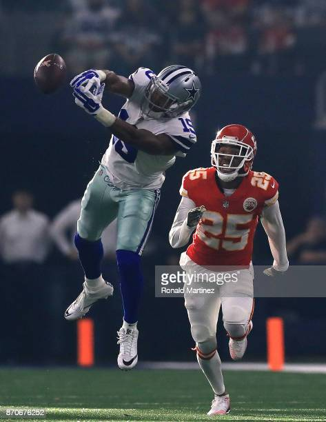 Brice Butler of the Dallas Cowboys drops a pass in front of Kenneth Acker of the Kansas City Chiefs in the second quarter at ATT Stadium on November...