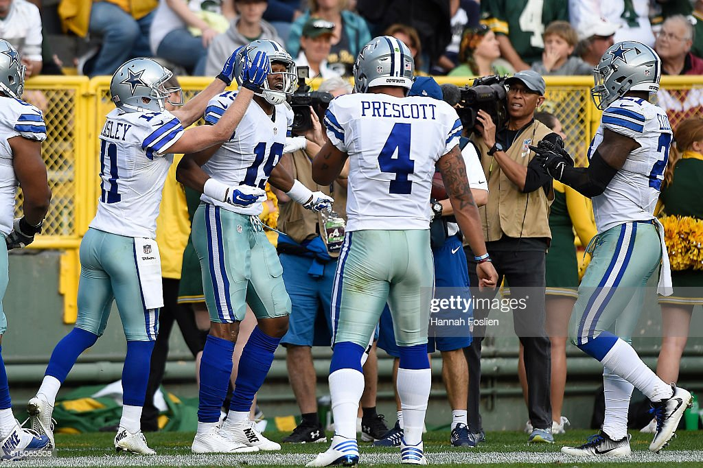 Brice Butler #19 of the Dallas Cowboys is congratulated by his teammates after scoring a second quarter touchdown against the Green Bay Packers during the second quarter at Lambeau Field on October 16, 2016 in Green Bay, Wisconsin.