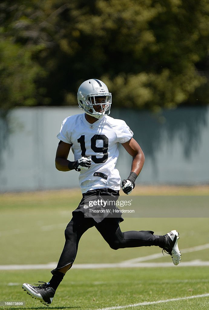 Brice Butler #19 of the Oakland Raiders participates in drills during Rookie Mini-Camp on May 11, 2013 in Alameda, California.