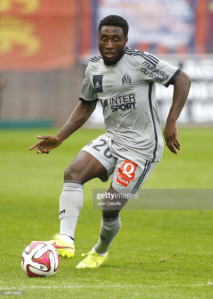 Brice Dja Djedje of OM in action during the French Ligue 1 match between Stade Malherbe de Caen and Olympique de Marseille at Stade Michel D'Ornano on October 4, 2014 in Caen, France.