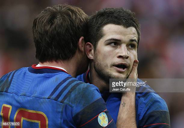 Brice Dulin is congratulated by Camille Lopez of France during the RBS Six Nations rugby match between France and Wales at Stade de France stadium on...