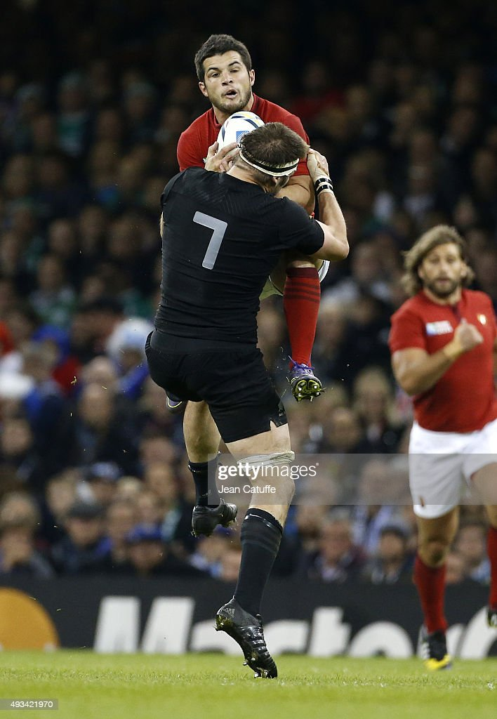 Brice Dulin of France and Richie McCaw of the New Zealand All Blacks in action during the 2015 Rugby World Cup Quarter Final match between New Zealand and France at the Millennium Stadium on October 17, 2015 in Cardiff, United Kingdom.