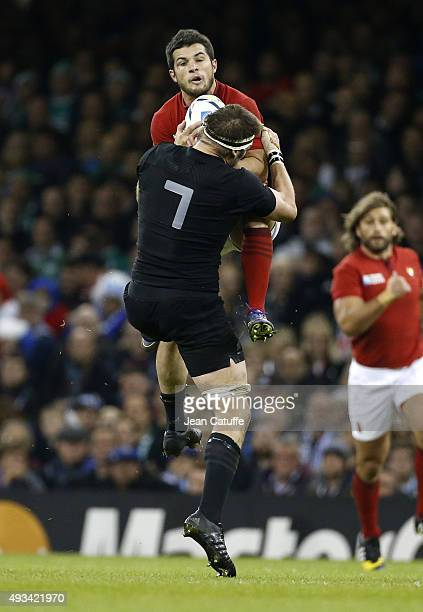Brice Dulin of France and Richie McCaw of the New Zealand All Blacks in action during the 2015 Rugby World Cup Quarter Final match between New...