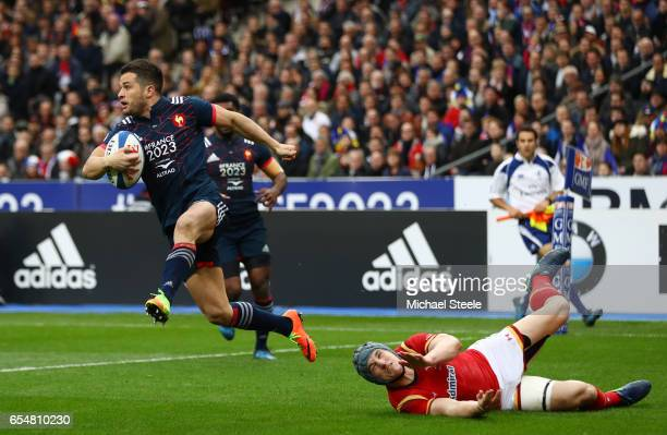 Brice Dulin of France evades the tackle from Jonathan Davies of Wales during the RBS Six Nations match between France and Wales at the Stade de...