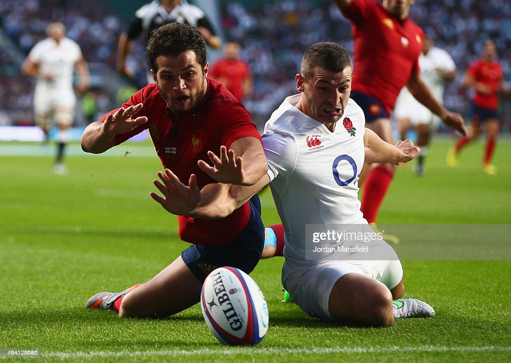 Brice Dulin of France fails to score a try challenged by <a gi-track='captionPersonalityLinkClicked' href=/galleries/search?phrase=Jonny+May&family=editorial&specificpeople=5813545 ng-click='$event.stopPropagation()'>Jonny May</a> of England during the QBE International match between England and France at Twickenham Stadium on August 15, 2015 in London, England.
