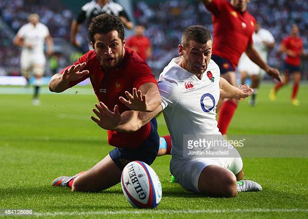 Brice Dulin of France fails to score a try challenged by Jonny May of England during the QBE International match between England and France at...