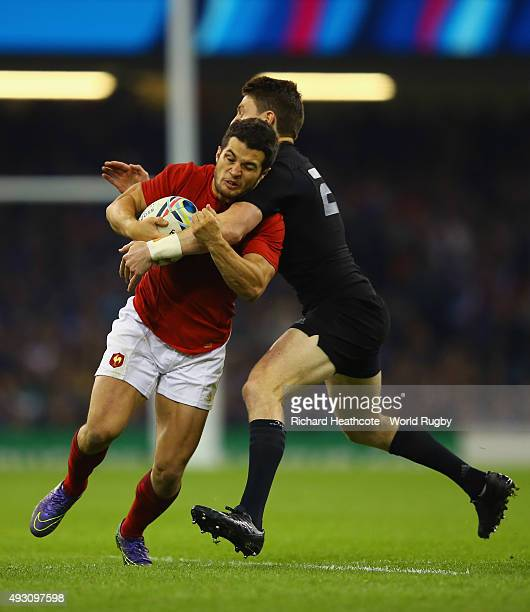 Brice Dulin of France is tackled by Beauden Barrett of the New Zealand All Blacks during the 2015 Rugby World Cup Quarter Final match between New...