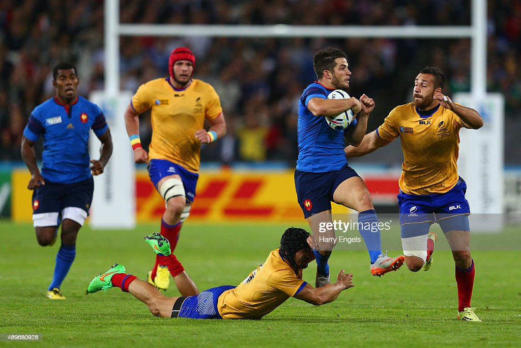 Brice Dulin of France is tackled by Catalin Fercu (ground) and Madalin Lemnaru (R) of Romania during the 2015 Rugby World Cup Pool D match between France and Romania at the Olympic Stadium on September 23, 2015 in London, United Kingdom.