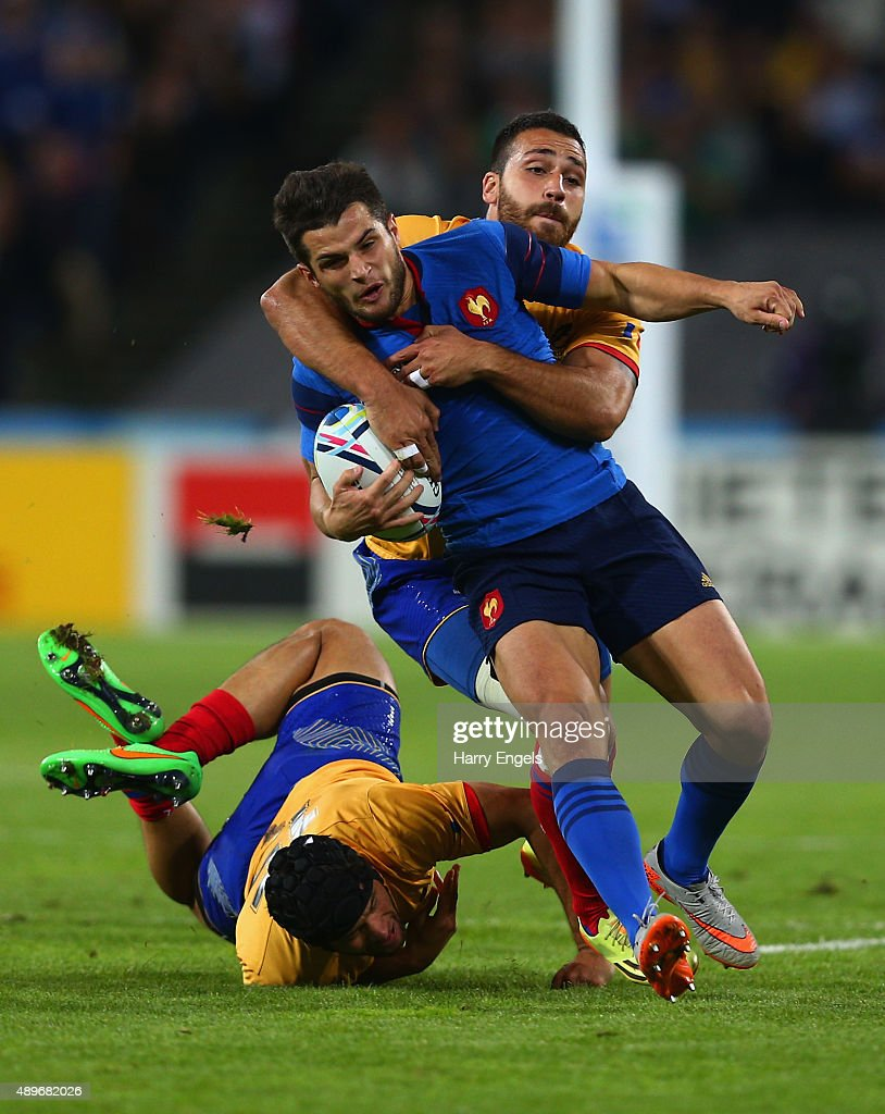 Brice Dulin of France is tackled by Catalin Fercu (ground) and Madalin Lemnaru of Romania during the 2015 Rugby World Cup Pool D match between France and Romania at the Olympic Stadium on September 23, 2015 in London, United Kingdom.