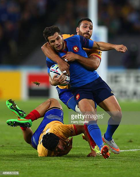 Brice Dulin of France is tackled by Catalin Fercu and Madalin Lemnaru of Romania during the 2015 Rugby World Cup Pool D match between France and...