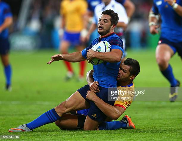 Brice Dulin of France is tackled by Catalin Fercu of Romania during the 2015 Rugby World Cup Pool D match between France and Romania at the Olympic...