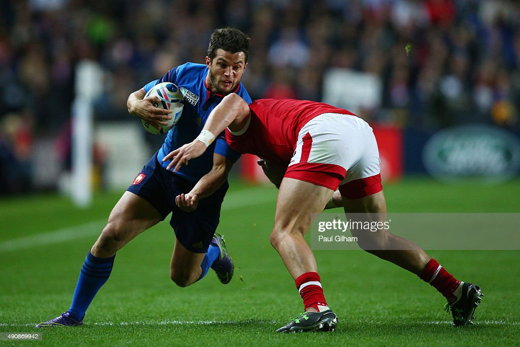 Brice Dulin of France is tackled by DTH Van Der Merwe of Canada during the 2015 Rugby World Cup Pool D match between France and Canada at Stadium mk on October 1, 2015 in Milton Keynes, United Kingdom.