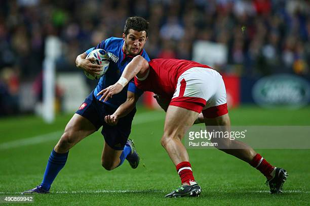 Brice Dulin of France is tackled by DTH Van Der Merwe of Canada during the 2015 Rugby World Cup Pool D match between France and Canada at Stadium mk...