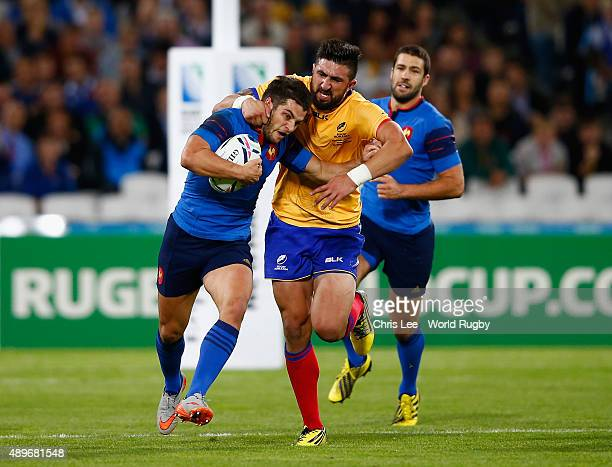 Brice Dulin of France is tackled by Florin Vlaicu of Romania during the 2015 Rugby World Cup Pool D match between France and Romania at the Olympic...