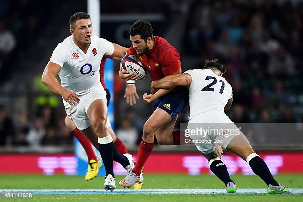 Brice Dulin of France is tackled by Sam Burgess and Danny Care of England during the QBE International match between England and France at Twickenham...