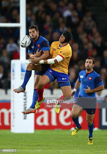 Brice Dulin of France jumps with Adrian Apostol of Romania during the 2015 Rugby World Cup Pool D match between France and Romania at the Olympic...