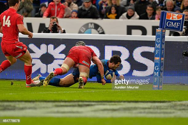 Brice Dulin of France scoring a try during the RBS Six Nations match between France and Wales at the Stade de France on February 28 2015 in Paris...